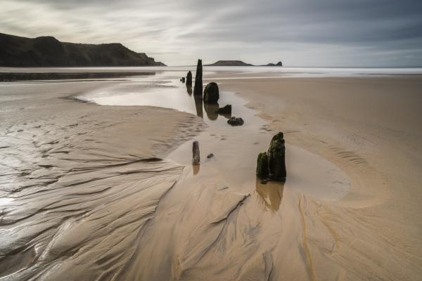 low tide sunset rhossilli bay gower