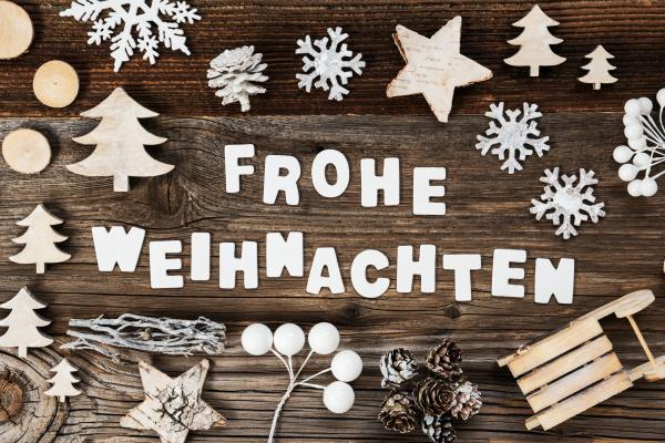 wooden decoration frohe weihnachten means merry
