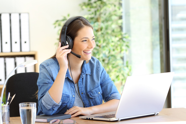 happy tele operator attending call looking