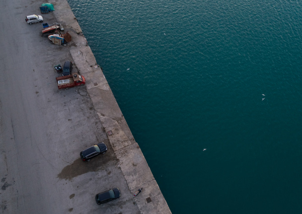 aerial view of cars parked at