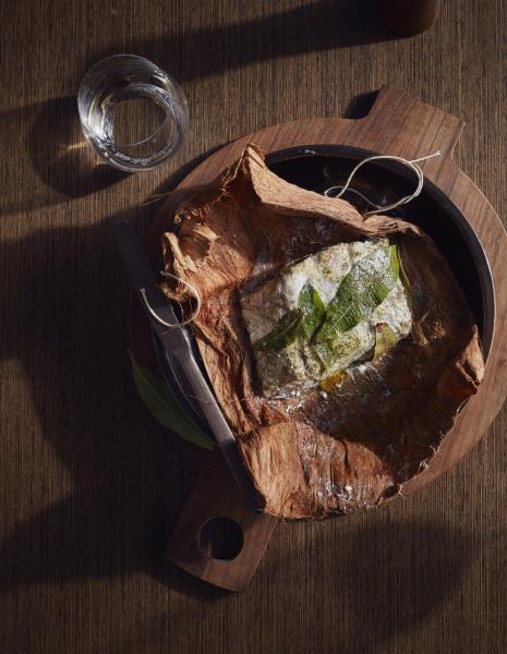 barramundi baked in paperbark served in