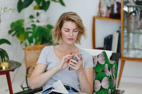 businesswoman using cellular phone in office