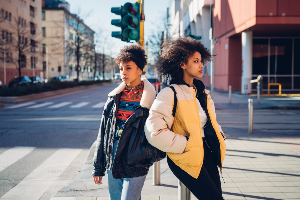 two cool young women standing on