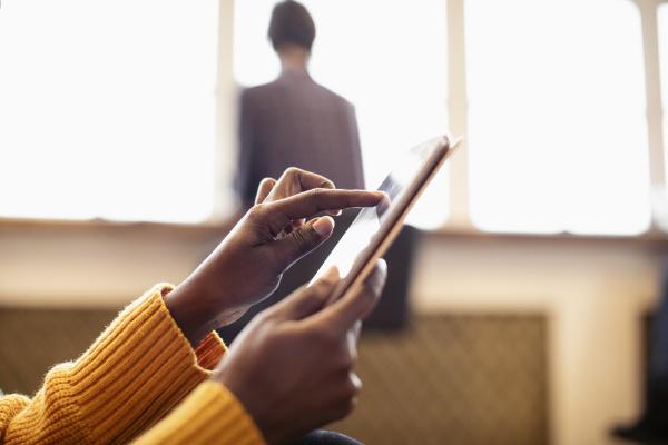 close up businesswoman using digital tablet