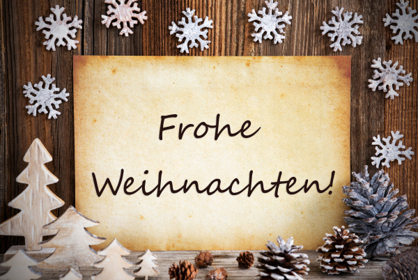 old paper decoration frohe weihnachten means