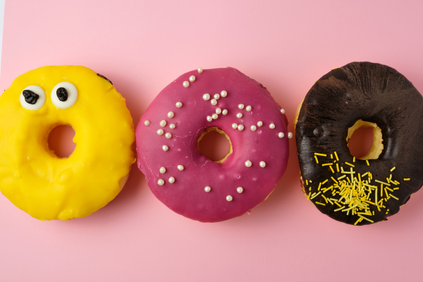three round different sweet donuts with