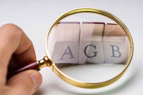 agb letters under magnifying glass