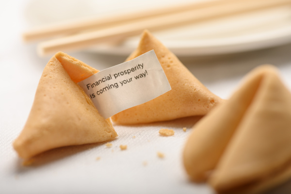 fortune cookies by chopsticks on plate