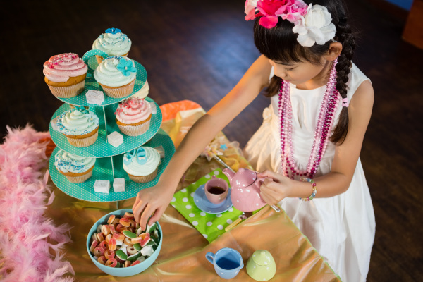 girl having tea and confectionery at