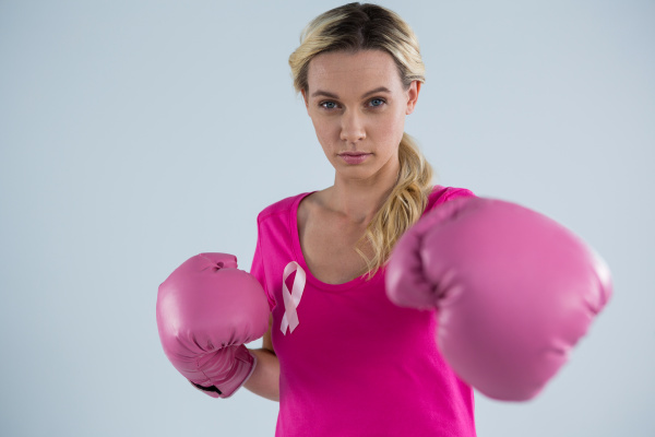 portrait of young woman punching with