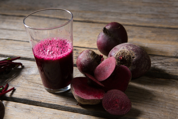 beetroot and beetroot juice on wooden