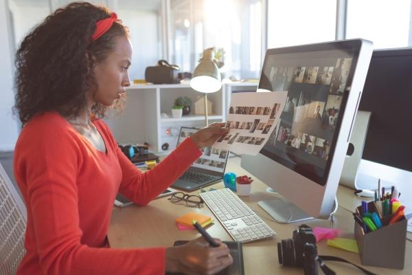 attentive female graphic designer working at