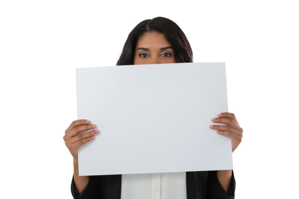 portrait of young businesswoman holding placard