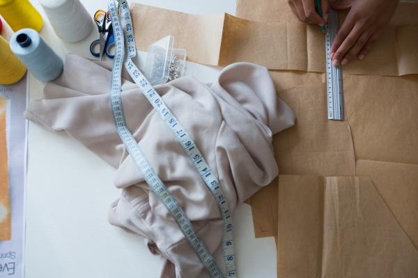 fashion designer marking on brown paper