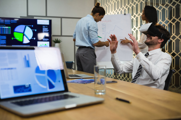 businessman using virtual reality headset while