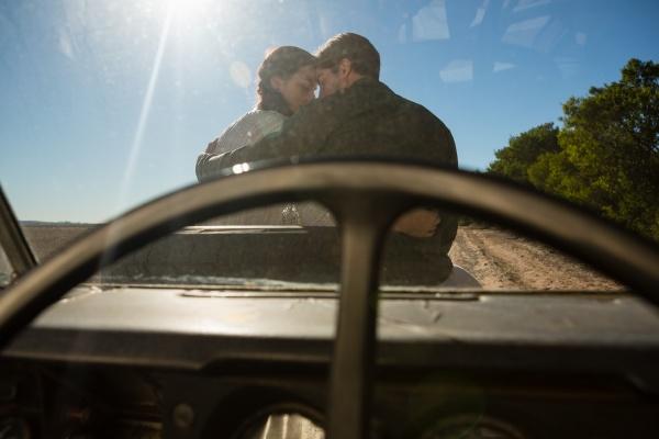 romantic couple seen through off road