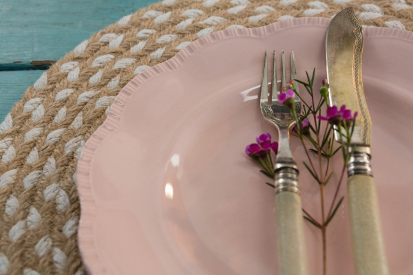 table setting on weathered wooden plank