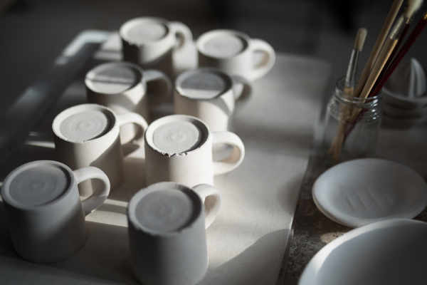close up of ceramic mugs arranged