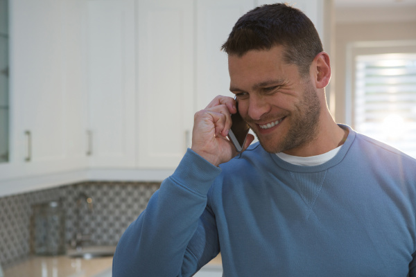 man talking on mobile phone in