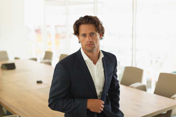 smart businessman sitting on a table