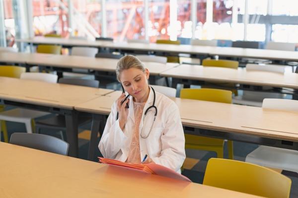 female doctor talking on mobile phone