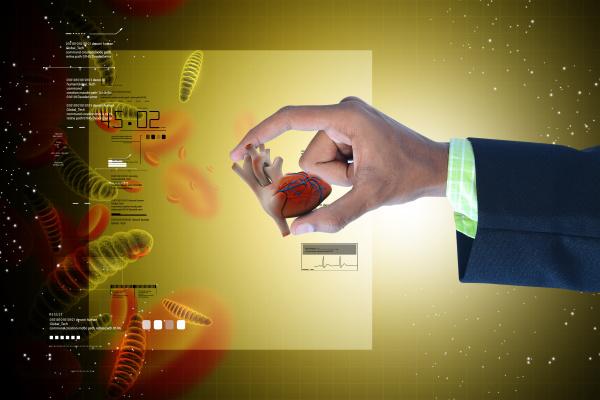 smart hand showing human heart