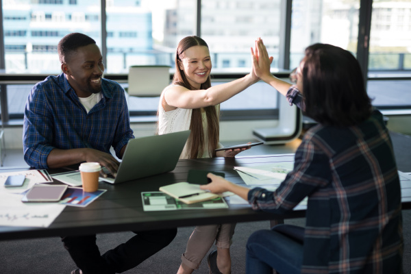 happy executives giving high five to