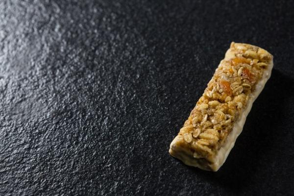 granola bar on black background