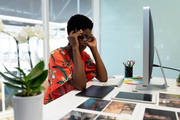 stressed female graphic designer sitting at