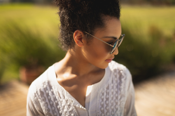young mixed race woman with sunglasses