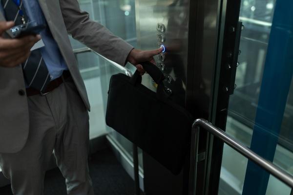 caucasian businessman using mobile phone in