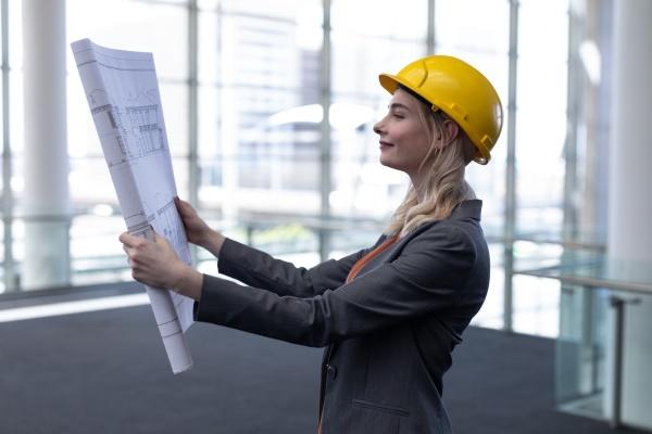 blonde caucasian female architect looking at