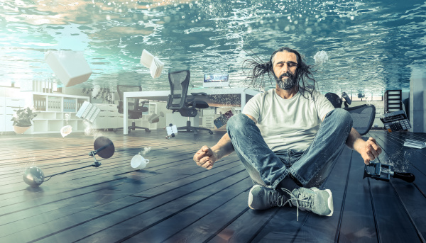 man sitting underwater who relaxes in