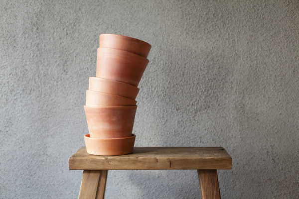 stack of plant pots on wooden
