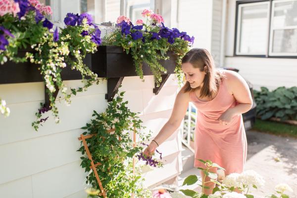 woman tending to flowers in garden