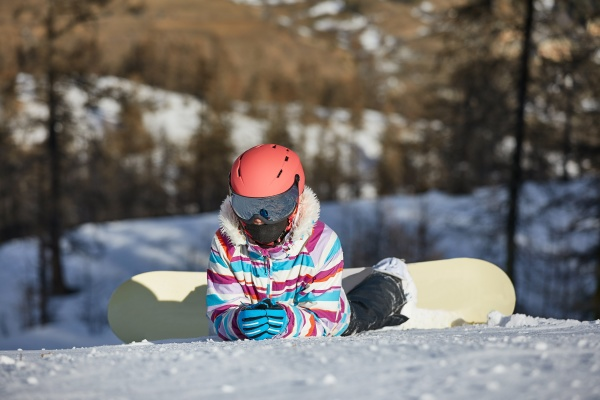 snowboarder resting in the snow