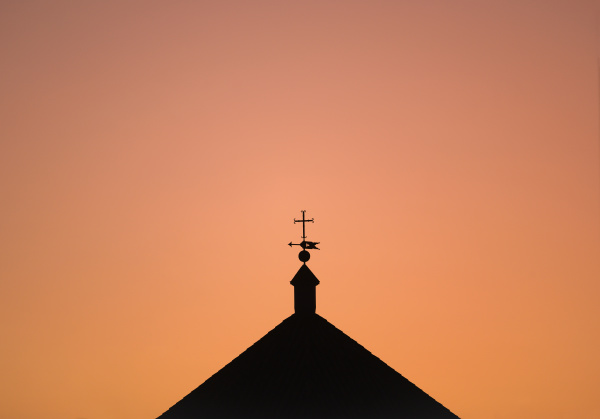 silhouette of church roof at sunset