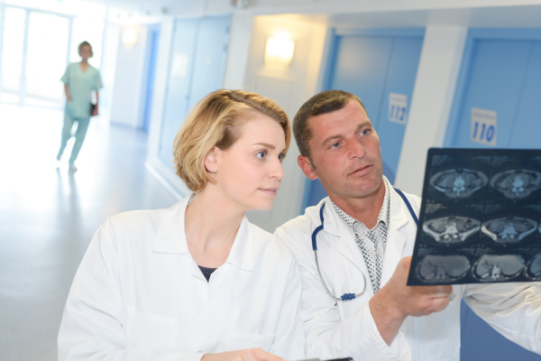 medical staff looking at xrays in