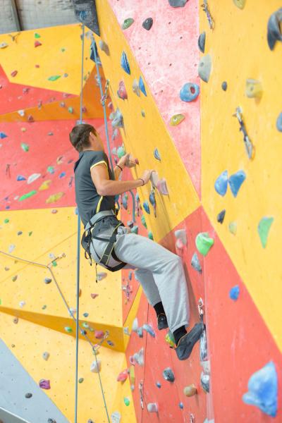 a man climbing indoor wall