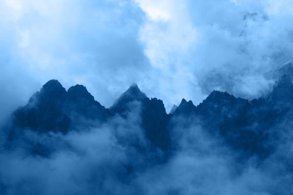 blue toned rocky mountain ridge in
