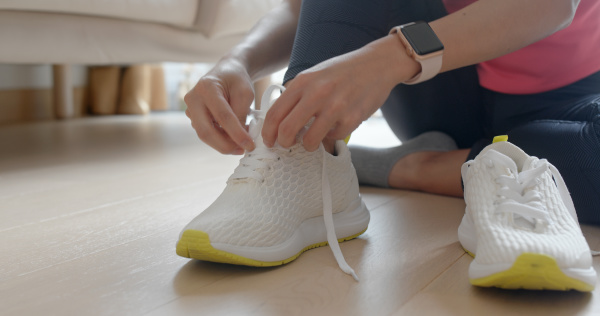 woman wearing sport shoes prepare for