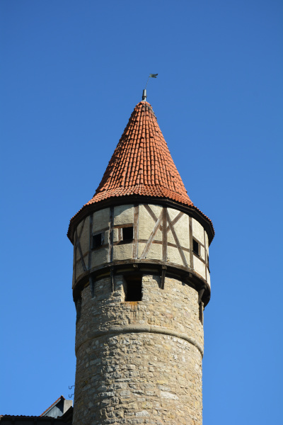 old round tower with red roof