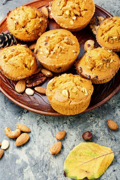 nut muffins on wooden background