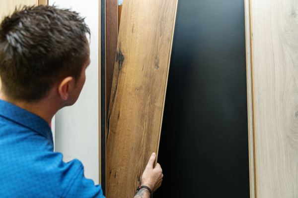 man choosing floor laminate for his