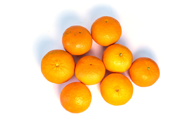 a pile of tangerines on a