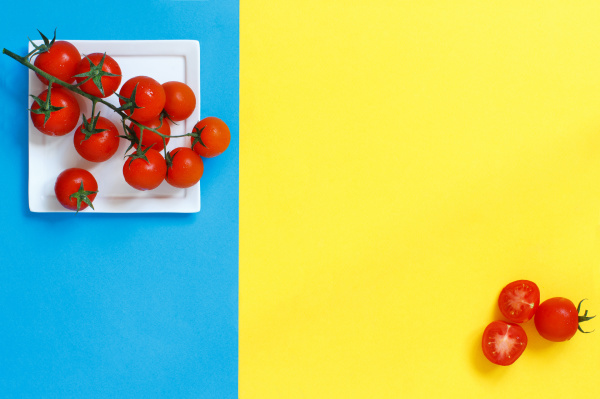 cherry tomatoes on a blue and