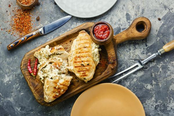 grilled chicken fillets on slate