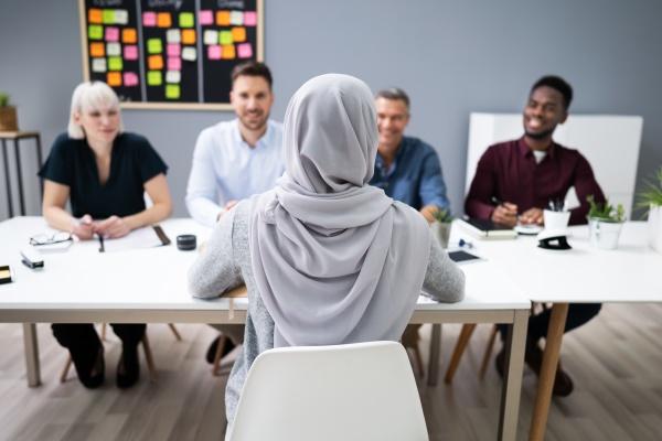 muslim woman in hijab sitting at