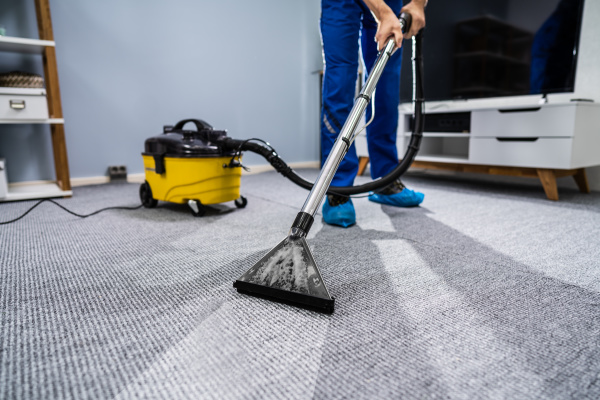 person, cleaning, carpet, with, vacuum, cleaner - 27955751