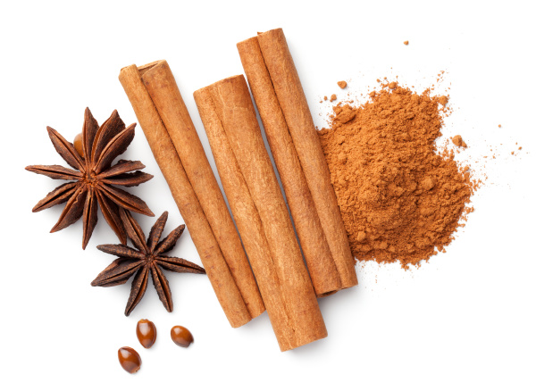 cinnamon sticks cinnamon powder pile anise